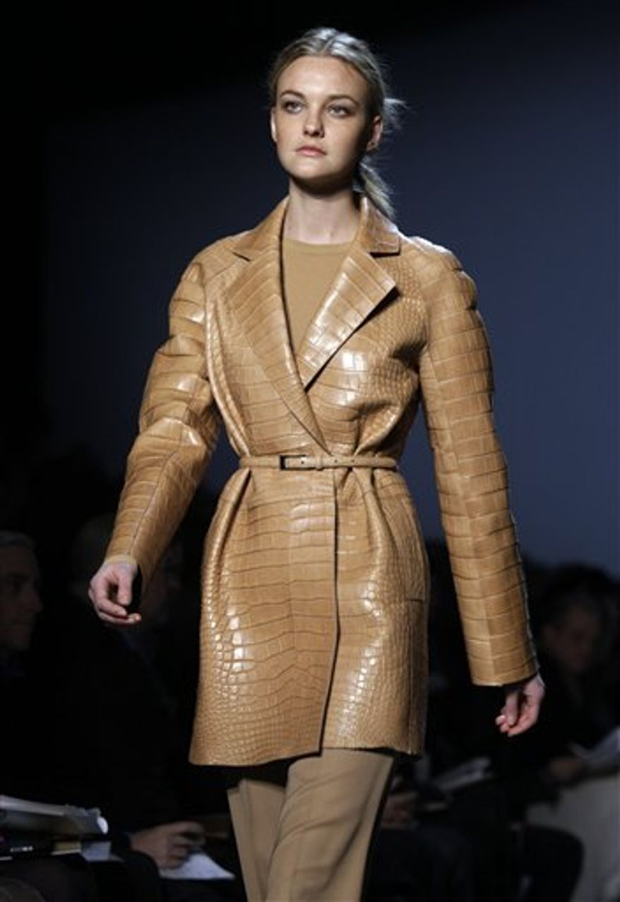 The fall 2011 collection of designer Michael Kors is modeled during Fashion Week in New York, Wednesday, Feb. 16, 2011. (AP Photo/Richard Drew)