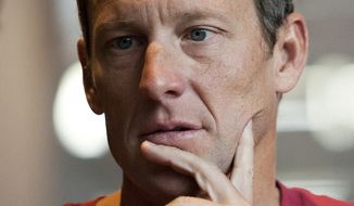Lance Armstrong speaks during an interview in Austin, Texas, on Tuesday, Feb. 15, 2011. (AP Photo/Thao Nguyen)