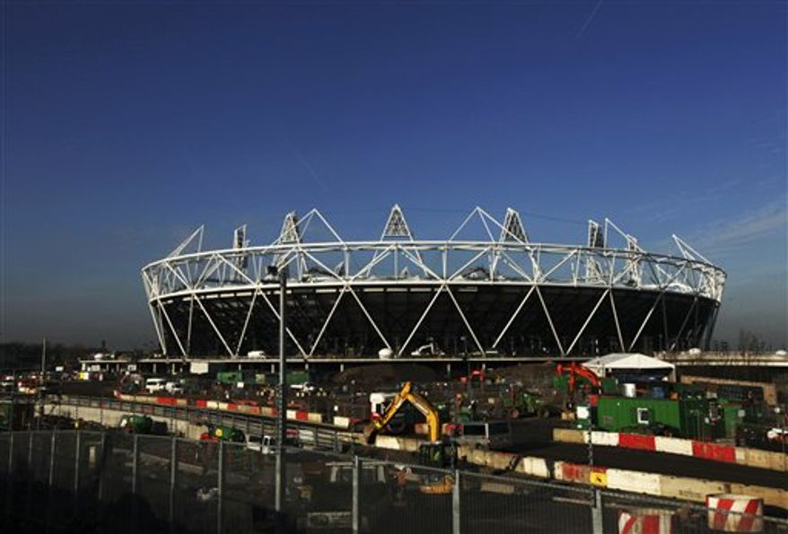 FILE - This is a  Friday, Jan. 21, 2011 file photo of the sun shining  on the main Olympic stadium  in London.  London organizers for the 2012 Olympic Games will release the full sports competition schedule for the Olympics on Tuesday Feb. 15, 2011.  (AP Photo/Matt Dunham, File)
