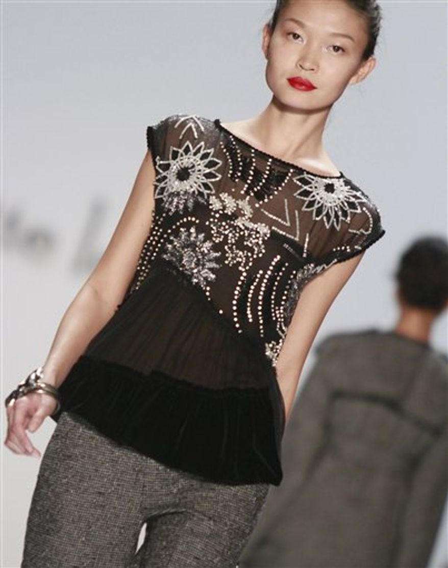 Fashion from the fall 2011 collection of Nanette Lepore is modeled on Wednesday, Feb. 16, 2011 in New York.  (AP Photo/Bebeto Matthews)
