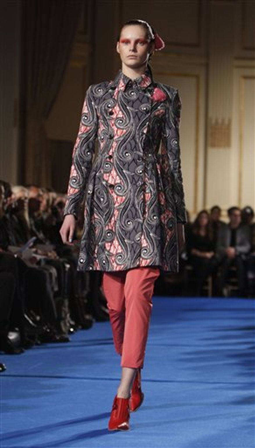 The Thakoon fall 2011 collection is modeled during Fashion Week Sunday, Feb. 13, 2011 in New York. (AP Photo/Jason DeCrow)