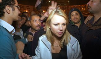 "In this Feb. 11, 2011, photo released by CBS, ""60 Minutes"" correspondent Lara Logan is shown covering the reaction in in Cairo's Tahrir Square the day Egyptian President Hosni Mubarak stepped down. CBS News says Logan was attacked Friday, and suffered a brutal beating and sexual assault before being saved by a group of women and an estimated 20 Egyptian soldiers. She is recovering in a U.S. hospital. (AP Photo/CBS News)"