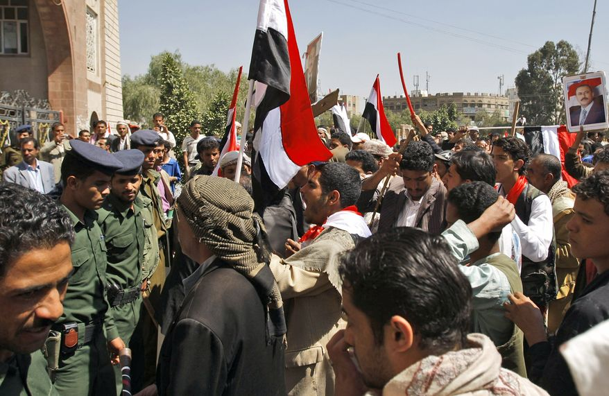 Police prevent Yemeni government supporters from entering Sanaa University, where anti-government protestors are gathered, in Sanaa, Yemen, on Wednesday, Feb. 16, 2011. The government sent 2,000 policemen into the streets of the capital to try to put down days of protests against the president of 32 years, a key U.S. ally in battling al Qaeda. (AP Photo/Hani Mohammed)