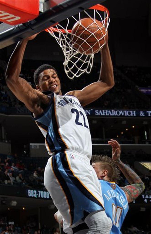 Memphis Grizzlies forward Rudy Gay (22) dunks past Denver Nuggets guard Chris Andersen (11) in the first half of an NBA basketball game on Sunday, Feb. 13, 2011, in Memphis, Tenn.   (AP Photo/Nikki Boertman)