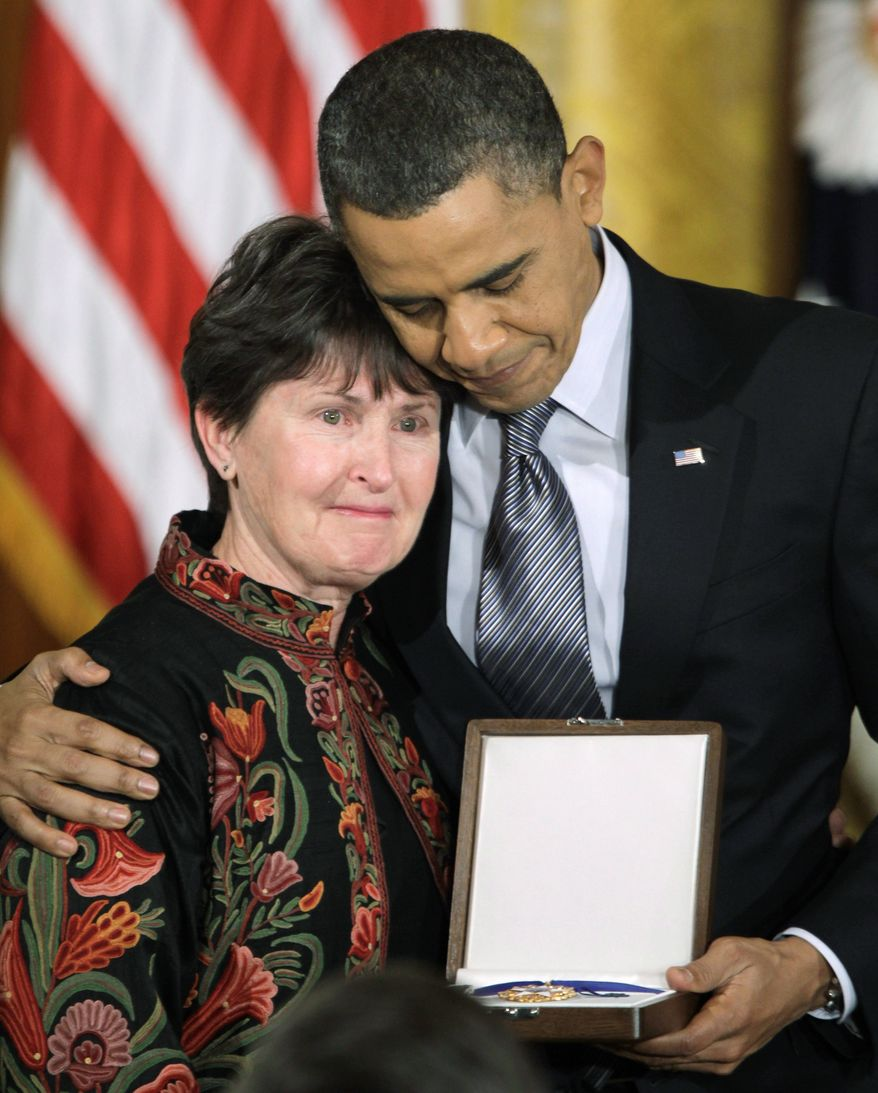 President Obama stands with Elizabeth Little, whose husband Dr. Tom Little, an optometrist killed in Afghanistan, was posthumously awarded a 2010 Medal of Freedom at the White House on Tuesday. (Associated Press)