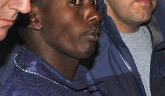 ** FILE ** In this April 20, 2009, file photo, FBI agents escort Abdiwali Abdiqadir Muse into FBI headquarters in New York. Muse has admitted he's a modern-day pirate. He was sentenced to 33 years in prison. (AP Photo/Louis Lanzano, File)