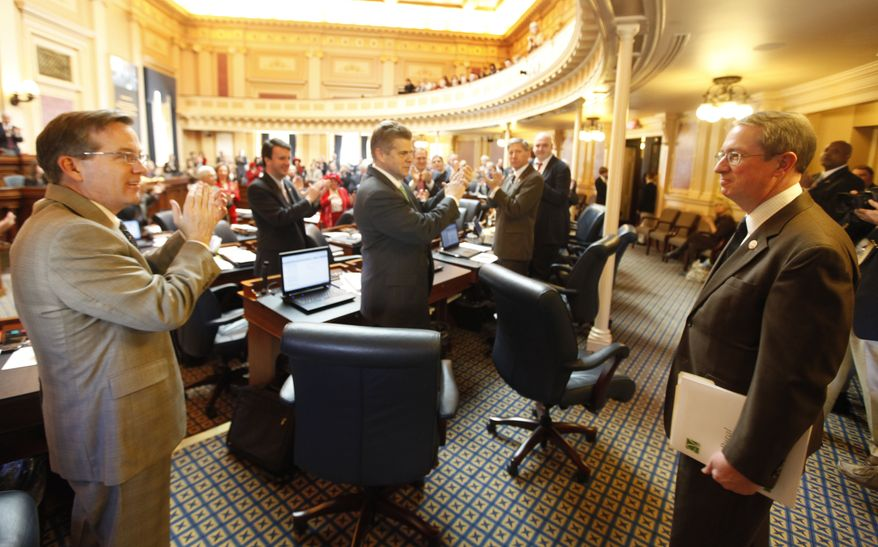 Rep. Robert Goodlatte, 6th District Republican, right, is introduced on the floor of the Virginia House of Delegates at the Capitol in Richmond, Va., on Feb. 14, 2011. (AP Photo/Steve Helber)