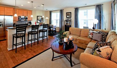 The Dylan model at the Residences at Dulles Parkway Center, a two-level upper-unit town-home-style condominium, has an open family room, center-island kitchen and breakfast area across the back of the main level. It is priced from $326,990 to $336,990.
