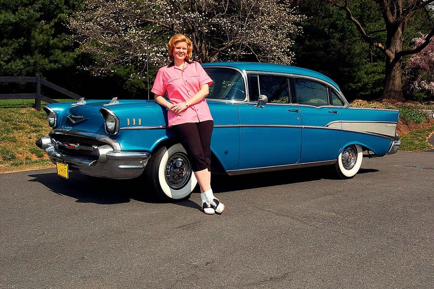 Theresa Werner has purchased a wardrobe to harmonize with her four-door 1957 Chevrolet Bel Air. (Bill O'Brien/The Washington Times)