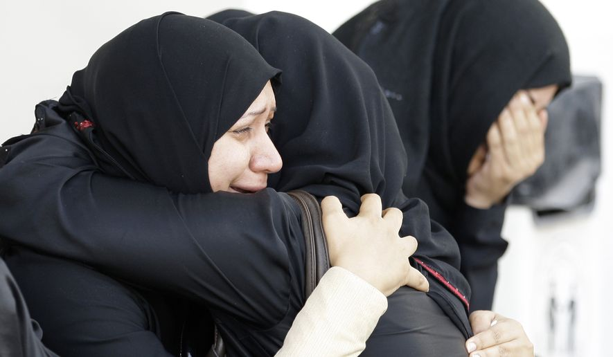 Bahraini women cry outside a hospital in capital Manama Thursday, Feb. 17, 2011, where victims of the confrontation between anti-government protesters and riot police were being treated. Armed patrols prowled neighborhoods and tanks appeared in the streets for the first time after riot police with tear gas and clubs drove protesters from a main square where they had demanded sweeping political change.(AP Photo/Hassan Ammar)