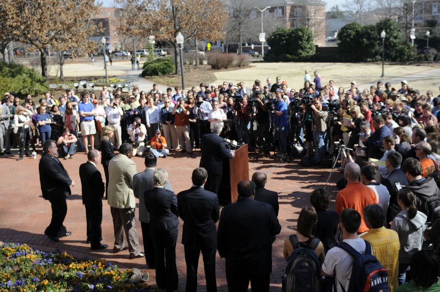 A crowd gathers as Auburn Police Chief Tommy Dawson speaks during a news conference at Samford Hall regarding the two poisoned oak trees at Toomer's Corner in Auburn, Ala., on Thursday, Feb. 17, 2011. Harvey Almorn Updyke, Jr., a 62-year-old Dadeville man has been arrested in connection with the poisoning of the historic Toomer's Corner oak trees at Auburn University. (AP Photo/The Birmingham News, Michelle Campbell)
