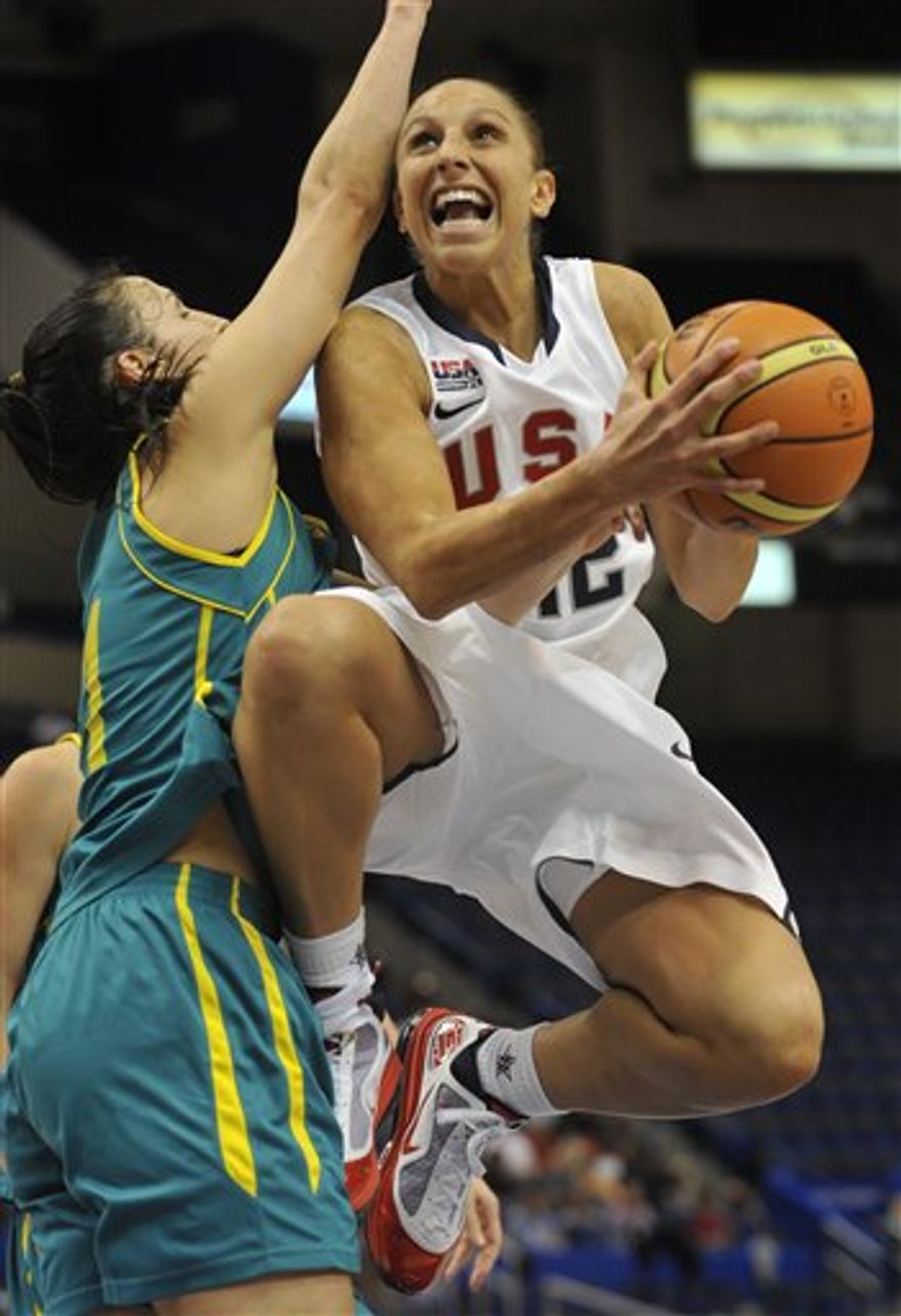 FILE - This Sept. 10, 2010, file photo shows USA's Diana Taurasi driving to the basket while guarded by Australia's Laura Summerton, left,  during the second half of an exhibition basketball game in Hartford, Conn.  Turkey's basketball federation lifted American star Diana Taurasi's provisional doping suspension Wednesday after a lab retracted its finding that she tested positive for a performance-enhancing substance. Taurasi not only is free to continue playing in the Turkish basketball league, she also is cleared to participate for the United States at the 2012 London Olympics. (AP Photo/Jessica Hill, File)