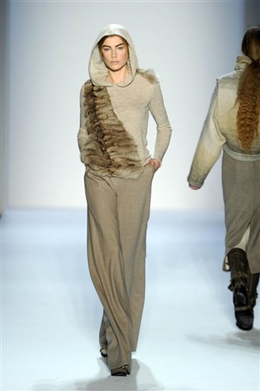 This Wednesday, Feb. 16, 2011 photo courtesy of Christian Cota shows the Christian Cota Fall 2011 collection modeled during Fashion Week in New York. (AP Photo/Christian Cota) NO SALES; EDITORIAL USE ONLY