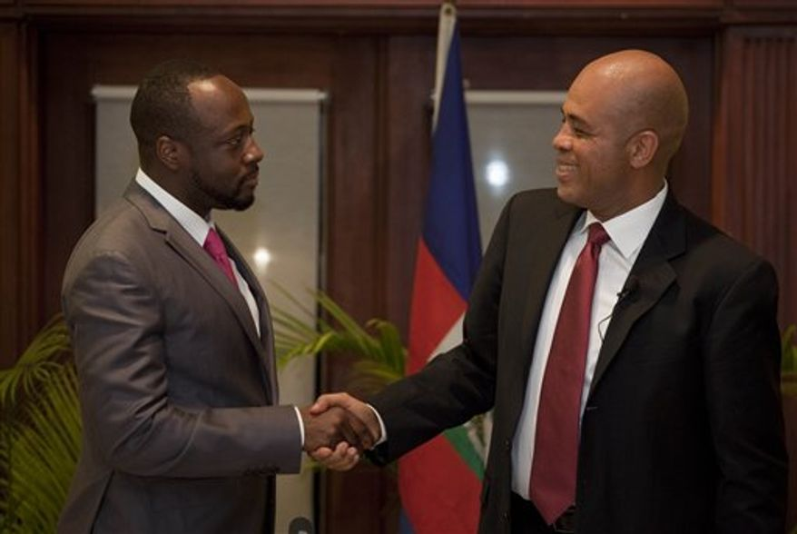 Haiti's presidential candidate Michel Martelly, right, and Haitian-born singer Wyclef Jean talk after a press conference announcing Jean's support on Martelly's run for the presidency in Port-au-Prince, Haiti, Wednesday, Feb. 16, 2011. (AP Photo/Ramon Espinosa)