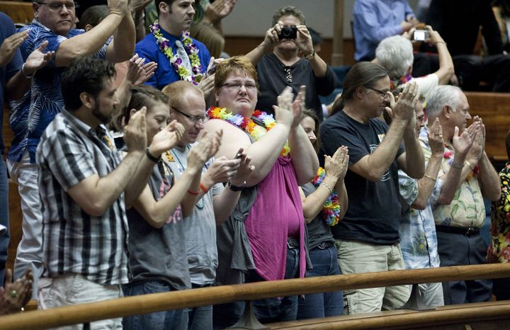 Supporters of the Hawaii Civil Unions Bill celebrate the state Senate's 18-5 vote to approve civil unions at the Hawaiian state Capitol on Wednesday, Feb. 16, 2011, in Honolulu. Gov. Neil Abercrombie has said he will sign the legislation into law. (AP Photo/Eugene Tanner)