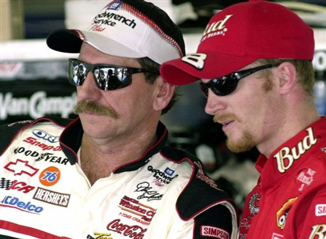 FILE - This Feb. 9, 2001, file photo shows NASCAR drivers Dale Earnhardt, left, and his son Dale Jr., standing together during a break in practice, at the Daytona International Speedway in Daytona Beach, Fla.  The 10-year anniversary of his father's death weighs heavily, almost preventing Earnhardt from enjoying the start of a new season. (AP Photo/Paul Kizzle, File)
