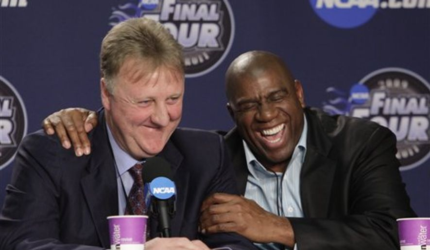 """FILE - In this April 6, 2009 file photo, former NBA players Earvin """"Magic"""" Johnson, right, and Larry Bird laugh at a news conference before the championship game between Michigan State and North Carolina at the men's NCAA Final Four college basketball tournament in Detroit. The producers and playwright behind the Broadway play """"Lombardi"""" are planning to go from football to basketball with """"Magic/Bird,"""" a new play that will chronicle the lives of Hall of Famers Larry Bird and Earvin """"Magic"""" Johnson.  (AP Photo/Paul Sancya, file)"""