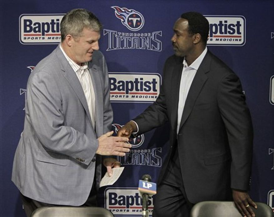 Tennessee Titans head coach Mike Munchak, left, introduces Jerry Gray at an NFL football news conference on Tuesday, Feb. 15, 2011, in Nashville, Tenn. Gray has been hired as the Titans' new defensive coordinator. (AP Photo/Mark Humphrey)