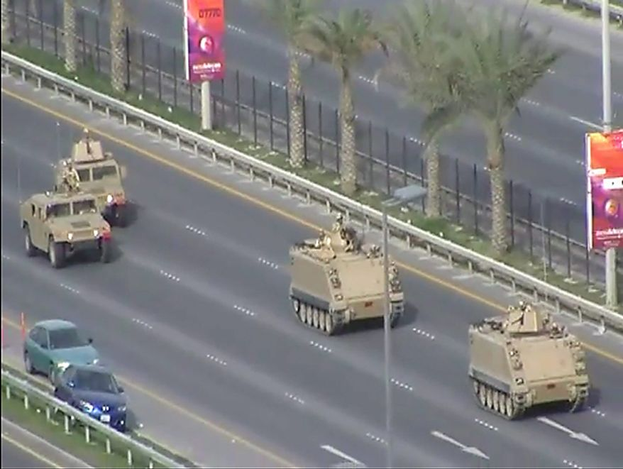In this image from video armored personnel carriers roll toward Pearl Square occupied by anti-government protesters Wednesday, Feb. 16, 2011. Riot police firing tear gas and wielding clubs stormed the landmark square occupied by anti-government protesters before dawn Thursday, driving out demonstrators and destroying a makeshift encampment that had become the hub for demands to bring sweeping political changes to the kingdom. (AP Photo/Tony Mitchell, HO)