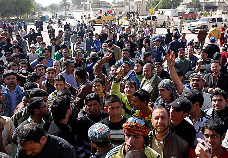 Iraqi protesters chant anti-government slogans in front of Kut's provincial headquarters building Thursday, Feb. 17, 2011. On Wednesday about 2,000 stone-throwing demonstrators attacked local government offices, setting fire to some buildings, including the governor's house. (AP Photo/Hadi Mizban)