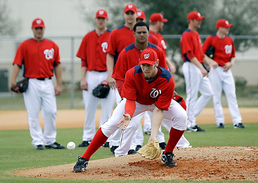 Washington Nationals starting pitcher Stephen Strasburg fields a ground ball during a drill at spring training on  Thursday, Feb. 17, 2011, in Viera, Fla. (AP Photo/David J. Phillip)