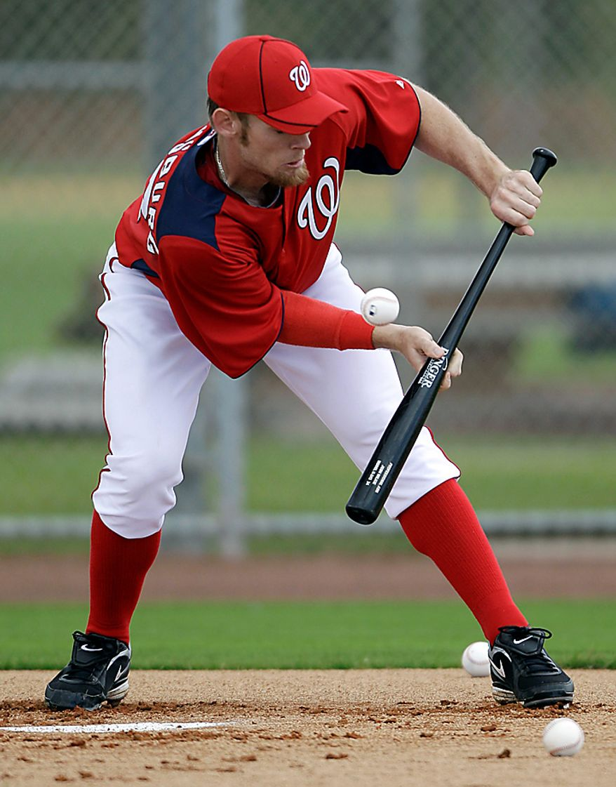 Washington Nationals pitcher Stephen Strasburg attempts to bunt a pitch during a spring training baseball workout Thursday, Feb. 17, 2011, in Viera, Fla. (AP Photo/David J. Phillip)