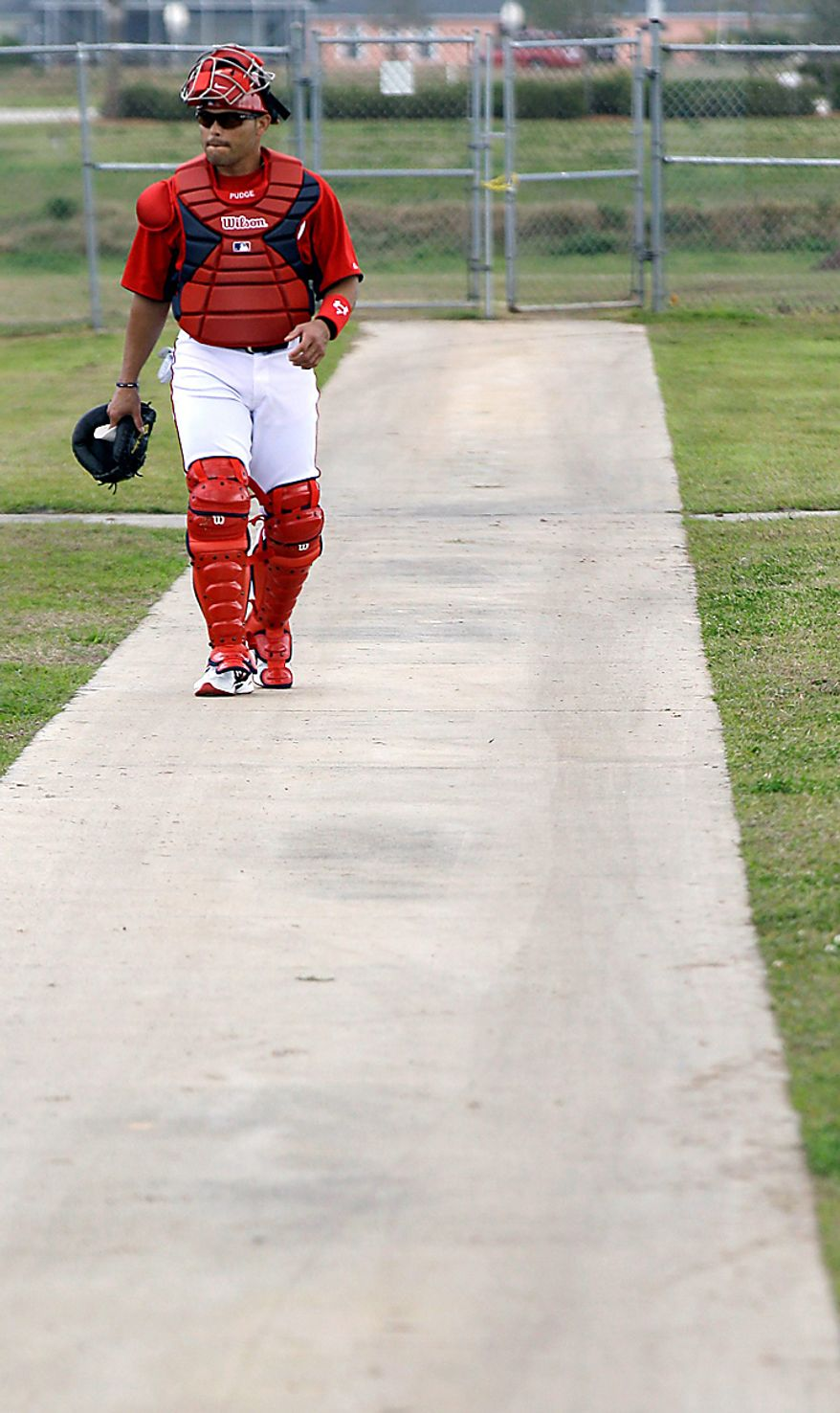 Washington Nationals catcher Ivan Rodriguez makes his way to a practice field during spring training baseball, Thursday, Feb. 17, 2011, in Viera, Fla. (AP Photo/David J. Phillip)