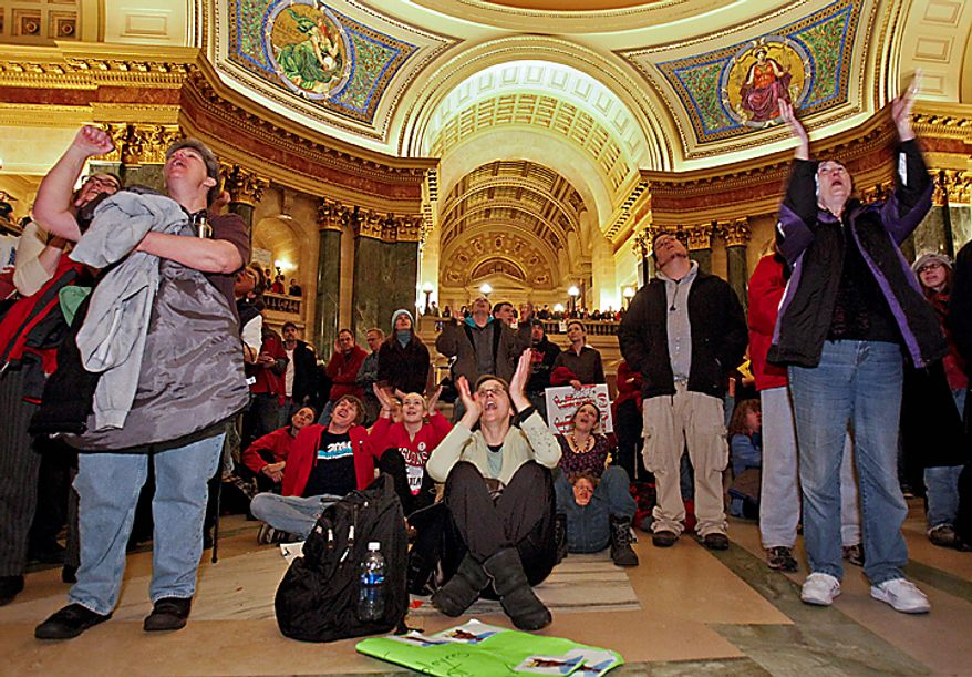 Darsi Foss, a nonunion state worker, listens to testimony from a Democratic state representative during a joint Finance Committee meeting at the Wisconsin Capitol in Madison, Wis., on Wednesday, Feb. 16, 2011. Protesters against Gov. Scott Walker's proposal to eliminate collective bargaining rights for many state workers are on the second day of demonstrations at the Capitol. (AP Photo/Andy Manis)