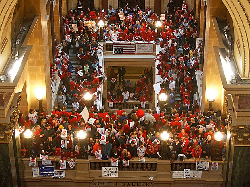 Protesters against Wisconsin Gov. Scott Walker's bill to eliminate collective bargaining rights for many state workers pack the Rotunda of the state Capitol in Madison, Wis., on Thursday, Feb. 17, 2011. (AP Photo/Andy Manis)