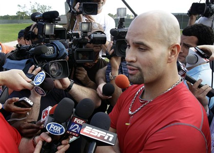 St. Louis Cardinals slugger Albert Pujols speaks to the media after arriving in camp for spring training baseball Thursday, Feb. 17, 2011, in Jupiter, Fla. The deadline for Pujols and the St. Louis Cardinals to reach a new contract agreement passed Wednesday with no new deal, making it likely the three-time MVP will test the free-agent market after the season. (AP Photo/Jeff Roberson)