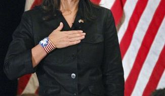 Former Alaska Gov. Sarah Palin covers her heart during the national anthem as she attends a public appearance at a Long Island Association (LIA) meeting and luncheon in Woodbury, N.Y., Thursday, Feb. 17, 2011. (AP Photo/Craig Ruttle)