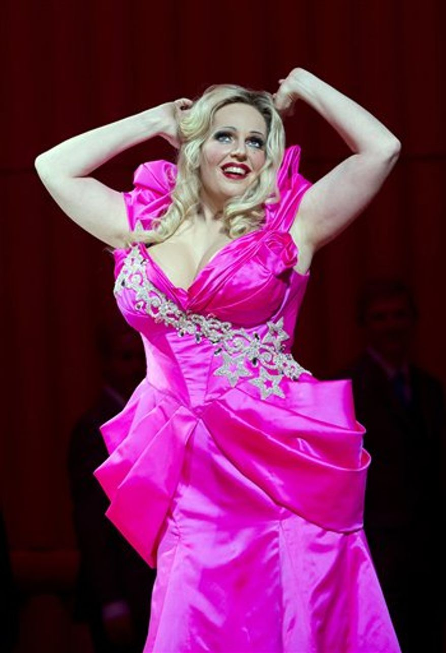"Undated photo released by The Royal Opera House, Covent Garden, London Friday Feb. 18, 2011 shows Dutch Soprano Eva Maria Westbroek as Anna Nicole in the title role of the Royal Opera House's production of ""Anna Nicole."" It's a rags-to-riches story with sex, drugs, vast wealth and family tragedy. Perfect material for an opera. Still, Britain's venerable Royal Opera raised some eyebrows when it announced that its next production would be based on the short, sensational life of Playboy Playmate-turned-tabloid-superstar Anna Nicole Smith. (AP Photo/Bill Cooper-HO Royal Opera House) EDITORIAL USE ONLY, NO SALES. ONLY FOR USE IN CONNECTION WITH THE ROYAL OPERA HOUSE PRODUCTION"