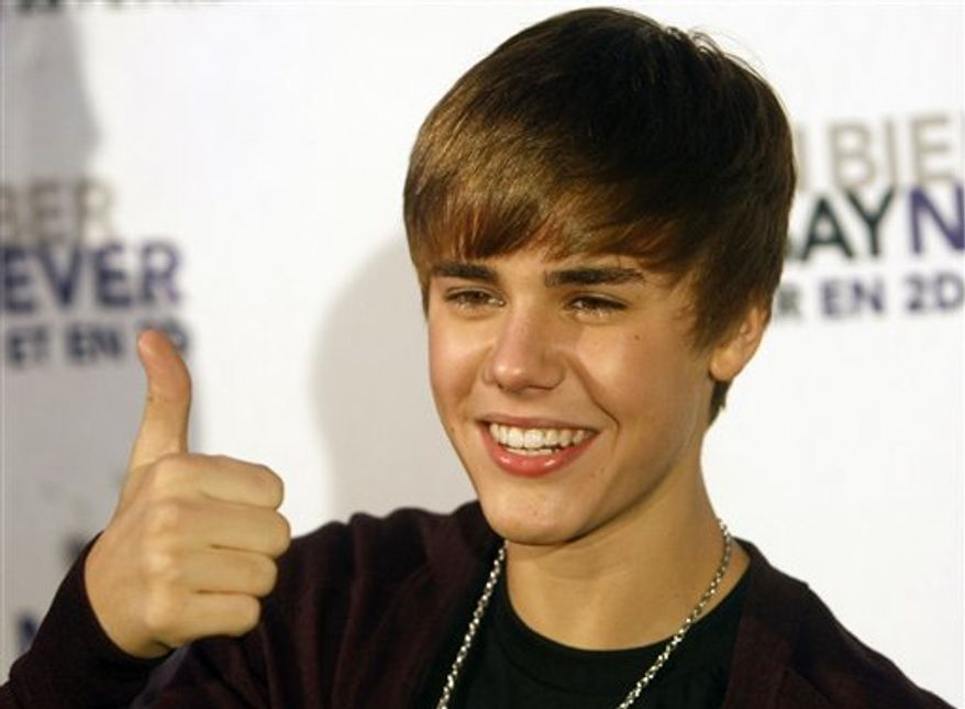 Canadian singer Justin Bieber attends at the Premiere of his film 'Justin Bieber: Never Say Never'  Thursday, Feb. 17, 2011,  in Paris. (AP Photo/Jacques Brinon)