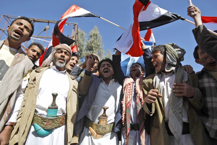 Supporters of the Yemeni government chant slogans during clashes with anti-government demonstrators in Sanaa, Yemen, Thursday, Feb. 17, 2011. Police opened fire on protesters during clashes in a southern Yemeni port, killing two people, in the first known deaths in six days of Egypt-style demonstrations across the country's biggest cities, demanding the ouster of the president, a key U.S. ally in battling al Qaeda. (AP Photo/Hani Mohammed)