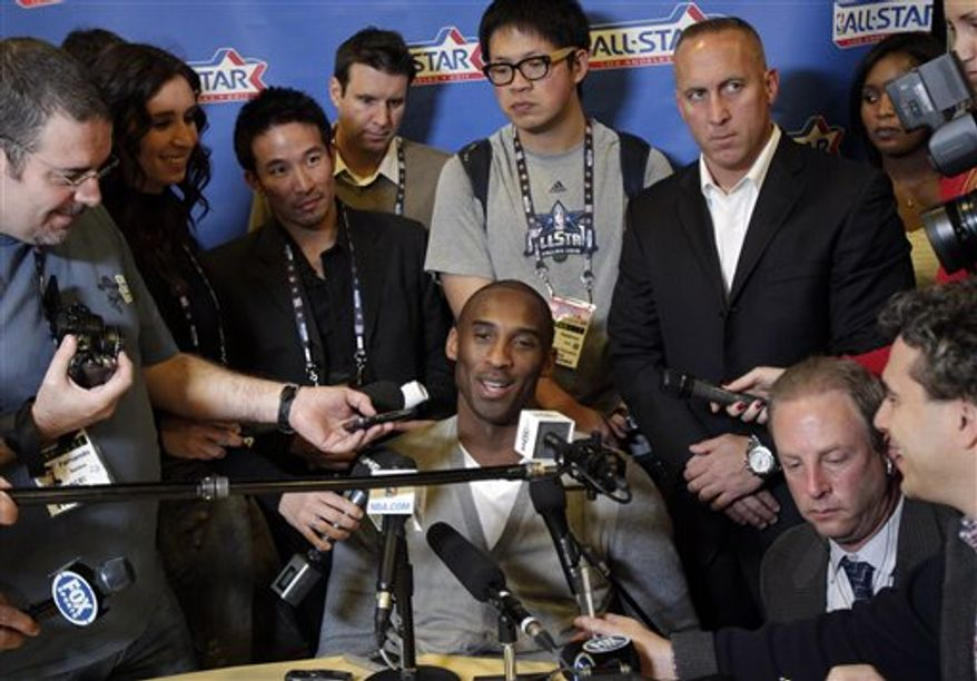 Denver Nuggets' Carmelo Anthony listens to a question from a reporter during media availability for the upcoming NBA All Star basketball game in Los Angeles, Friday, Feb. 18, 2011. (AP Photo/Jae C. Hong)