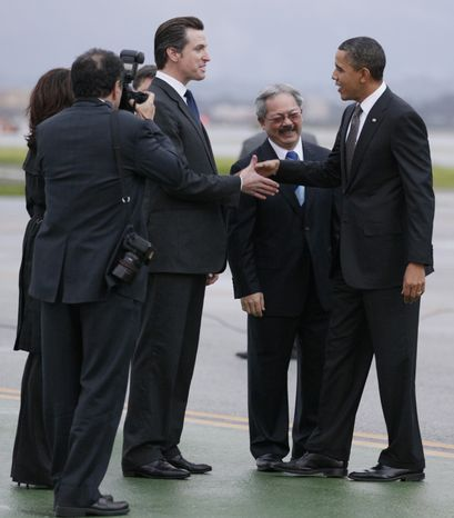President Obama, right, is greeted by California Lt. Gov. Gavin Newsom, third from right, and San Francisco Mayor Ed Lee as he arrives at San Francisco International Airport Thursday, Feb. 17, 2011. (AP Photo/Carolyn Kaster)