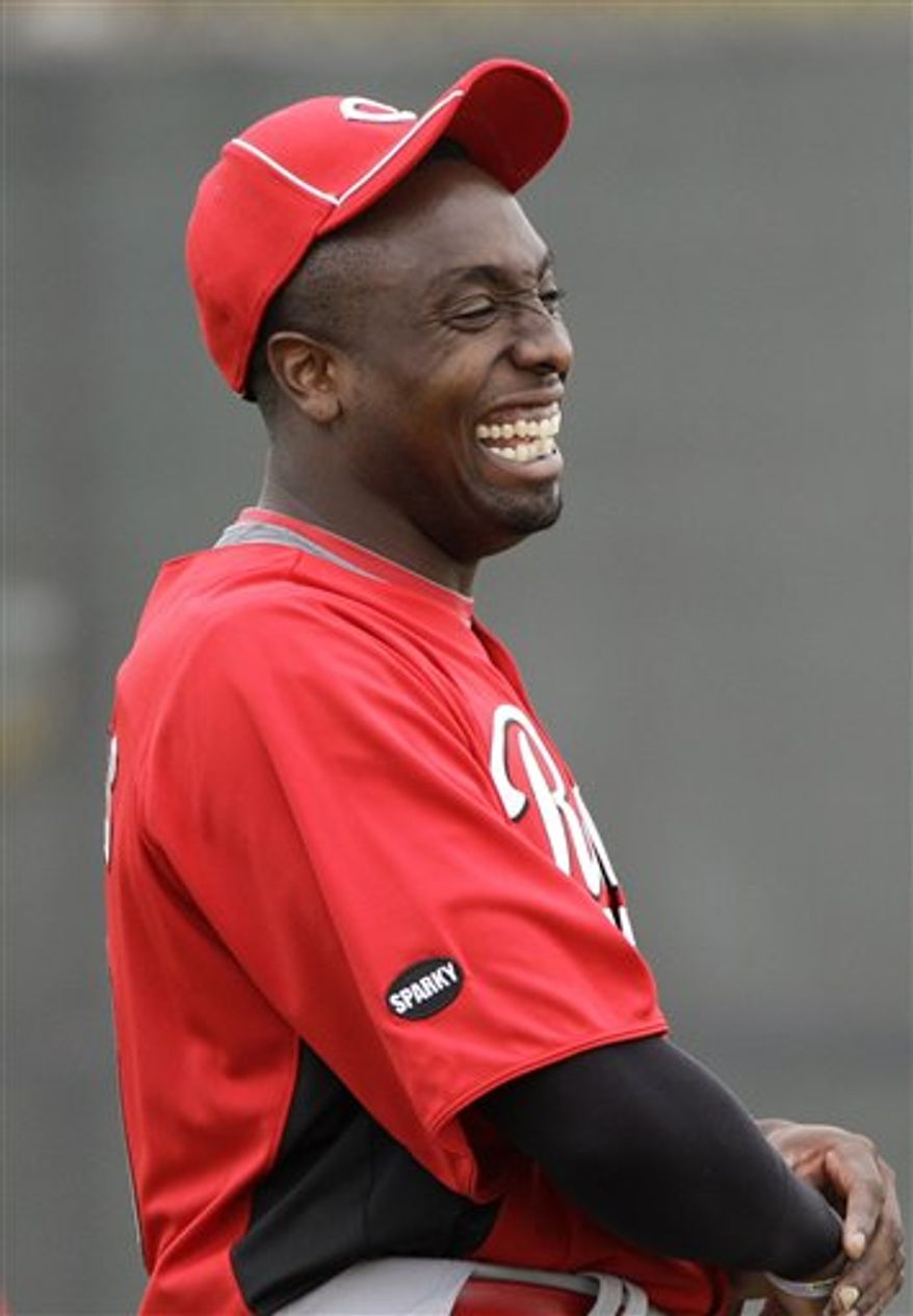 Cincinnati Reds starting pitcher Dontrelle Willis laughs during baseball spring training Friday, Feb. 18, 2011, in Goodyear, Ariz. (AP Photo/Mark Duncan)