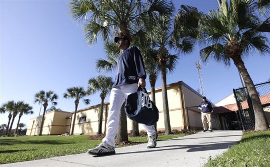 In this photo taken Monday, Feb. 14, 2011, Detroit Tigers pitcher Justin Verlander makes his way to the practice field for a baseball spring training workout in Lakeland, Fla. (AP Photo/David J. Phillip)