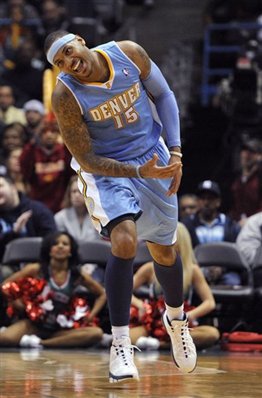 Denver Nuggets' Carmelo Anthony (15) reacts after making a basket against the Milwaukee Bucks during the second half of an NBA basketball game Wednesday, Feb. 16, 2011, in Milwaukee. The Nuggets defeated the Bucks 94-87. (AP Photo/Jim Prisching)