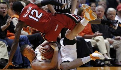 Tennessee's Steven Pearl, bottom, battles for the ball with South Carolina's Ramon Galloway (12) during the first half of an NCAA college basketball game Wednesday, Feb. 16, 2011, in Knoxville, Tenn. (AP Photo/Wade Payne)