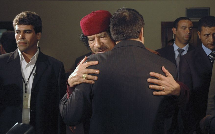 ** FILE ** In this Tuesday, June 10, 2008, file photo, Libyan leader Moammar Gadhafi, facing, embraces Tunisia's then President Zine El Abidine Ben Ali at an Arab mini-summit, in the capital Tripoli, Libya. Libyan special forces stormed a two-day-old protest encampment in the country's second largest city of Benghazi, clearing the area early Saturday, Feb. 19, 2011, said witnesses, as a human rights group estimate scores of people have died in the harsh crackdown on days of demonstrations. (AP Photo/Abdel Meguid Al-Fergany, File)