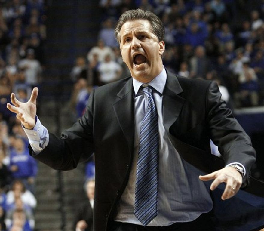 Kentucky coach John Calipari directs his players during the second half of an NCAA college basketball game against Mississippi State in Lexington, Ky., on Tuesday, Feb. 15, 2011. Kentucky won 85-79. (AP Photo/James Crisp)