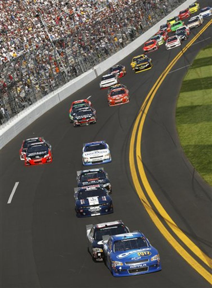Driver Tony Stewart, front, leads the field during the DRIVE4COPD 300 NASCAR Nationwide series auto race at Daytona International Speedway in Daytona Beach, Fla., Saturday, Feb. 19, 2011. (AP Photo/Chris Graythen, Pool)