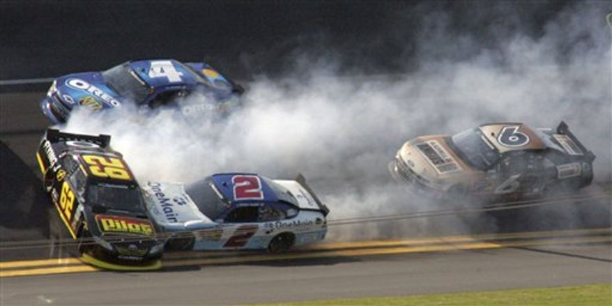 Driver Michael Annett (62), Elliott Sadler (2), Tony Stewart (4) and Ricky Stenhouse Jr (6) are involved in a crash during the DRIVE4COPD 300 NASCAR Nationwide series auto race at Daytona International Speedway in Daytona Beach, Fla., Saturday, Feb. 19, 2011. (AP Photo/Jim Topper)