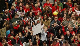 Opponents of Gov. Scott Walker's bill to eliminate collective bargaining rights for many state workers protest in the Rotunda of the Capitol in Madison, Wis., on Friday, Feb. 18, 2011. (AP Photo/Andy Manis)