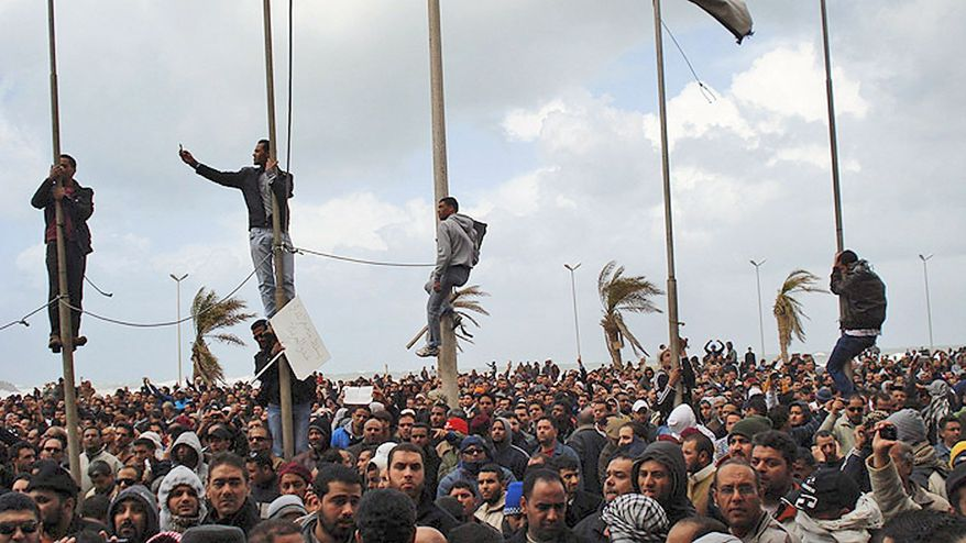 This photograph, taken by a person not employed by AP, shows people gathering during unrest in Benghazi, the second-largest city in Libya. Residents of the city told reporters by telephone that it was liberated Sunday after soldiers threw their lot with protesters. The claim could not be immediately confirmed. (Associated Press)