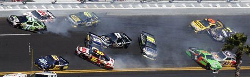 The cars of Andy Lally (71), Brian Keselowski (92), Joe Nemecheck (87), AJ Allmendinger (43), Greg Biffle (16), Michael Waltrip (15), Matt Kenseth (17), Jimmie Johnson (48), Mark Martin (5), Brian Vickers (83), Marcos Ambrose (9), and David Reutimann (00) crash during the Daytona 500 NASCAR auto race at Daytona International Speedway in Daytona Beach, Fla., Sunday, Feb. 20, 2011. (AP Photo/Glenn Smith)