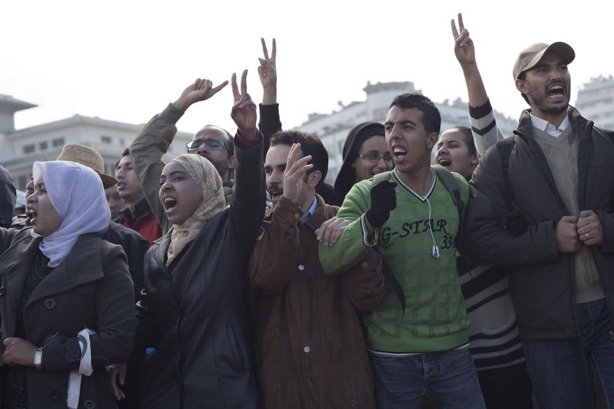 Protesters are seen during a demonstration on Sunday in Casablanca, Morocco. Thousands of people marched in cities across Morocco on Sunday, demanding a new constitution to bring more democracy in the North African kingdom amid the wave of Arab world upheaval. (Associated Press)