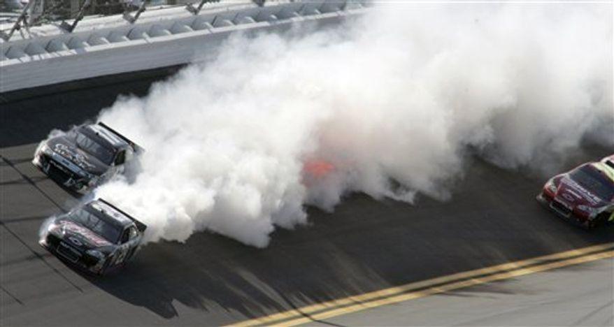 Smoke billows from Kevin Harvick's car (29) after an engine problem during the Daytona 500 NASCAR auto race at Daytona International Speedway in Daytona Beach, Fla., Sunday, Feb. 20, 2011. (AP Photo/Jim Topper)