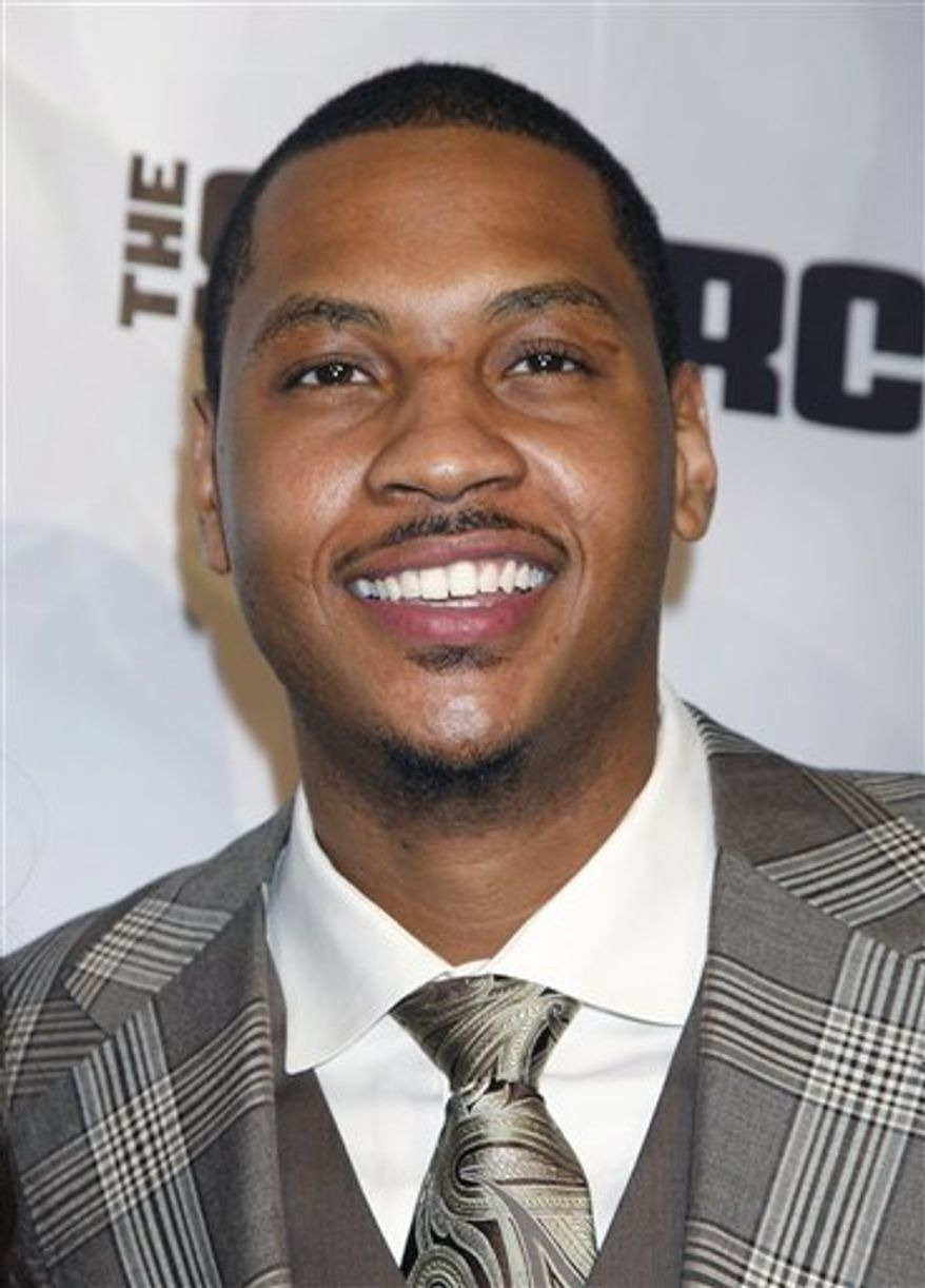 NBA player Carmelo Anthony, right, and entertainer La La Vazquez arrive at the The National Basketball Players Association (NBPA) All-Star Gala in Los Angeles, Saturday, Feb. 19, 2011. (AP Photo/Jason Redmond)